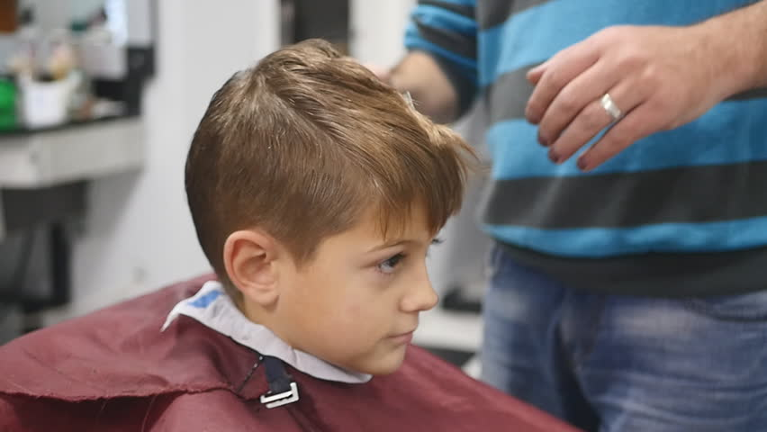 The Man Is Standing And Making Haircut For Small Boy Stock - Hairstyle boy hd