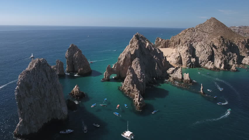 Aerial shot of El Arco arch. Cliffs and rocks - Cabo San Lucas, Mexico | Shutterstock HD Video #23521108