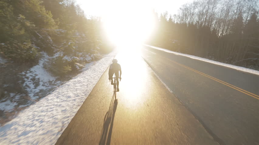 Man Cycling Up Mountain in Winter in Vancouver