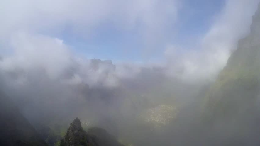 Time-lapse of clouds/mist flowing into Nun's Valley/Curral das Freiras, Madeira, Portugal