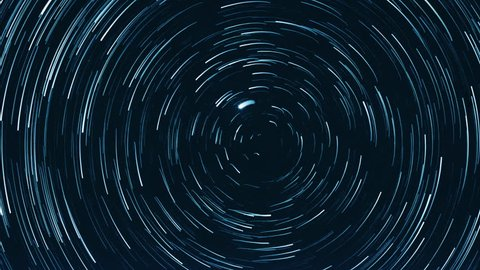 Starry sky time lapse with the star trails like comets. North Pole Star (Alpha Ursae Minoris) is in the center.