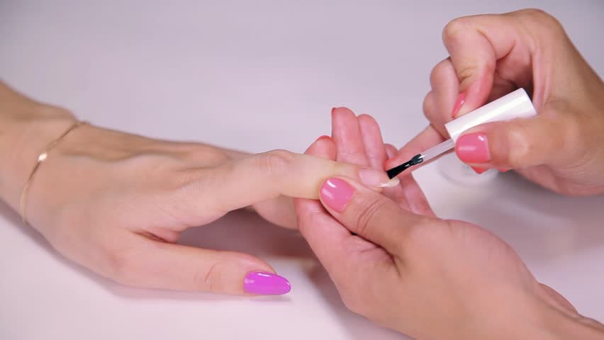 Stock video of woman cosmetician painting nail polish | 23549392 ...