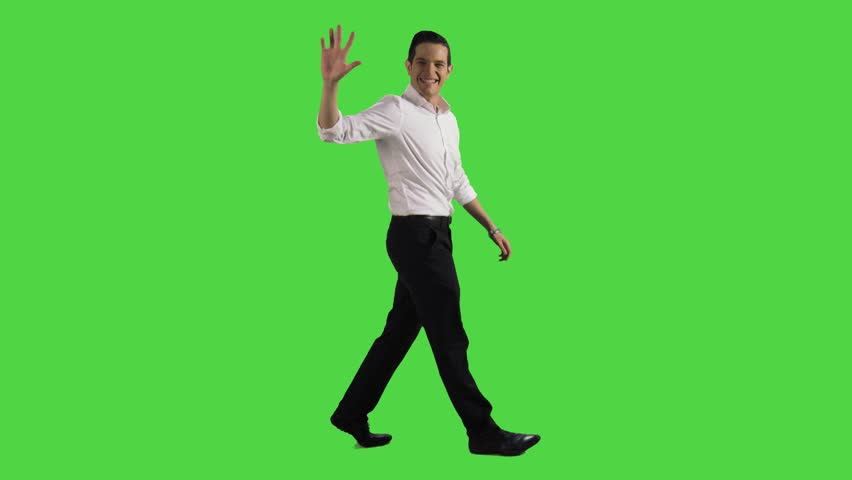 Young businessman walking relaxed, points forward while walking sideways over a greenscreen #23657665