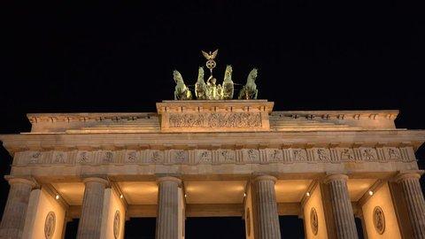 4K Amazing Brandenburg Gate monument silhouette by night, Berlin landmark symbol