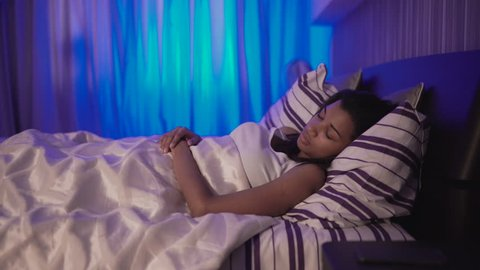 African woman sleeping in bedroom. UHD 4K