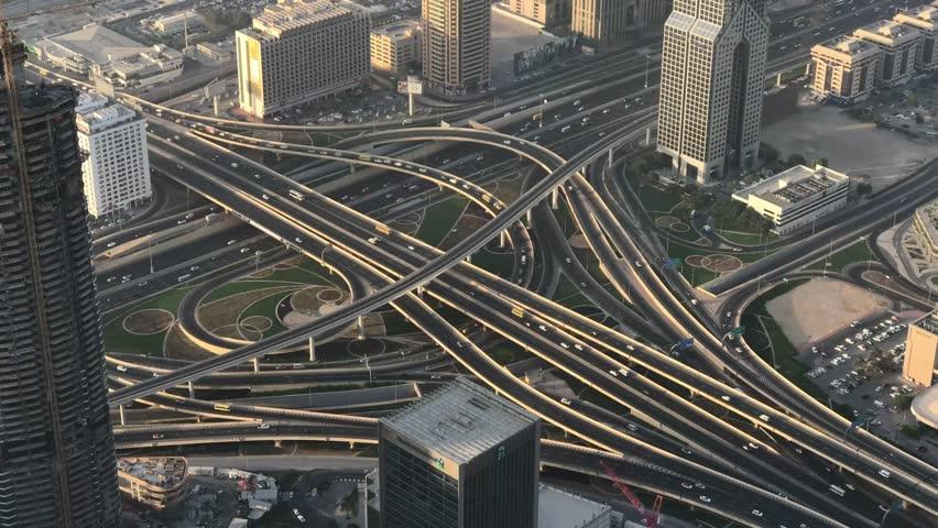 DUBAI, UAE - DECEMBER 2016: Time lapse of traffic intersections, aerial view. Dubai suffers heavy car traffic. | Shutterstock HD Video #23743045