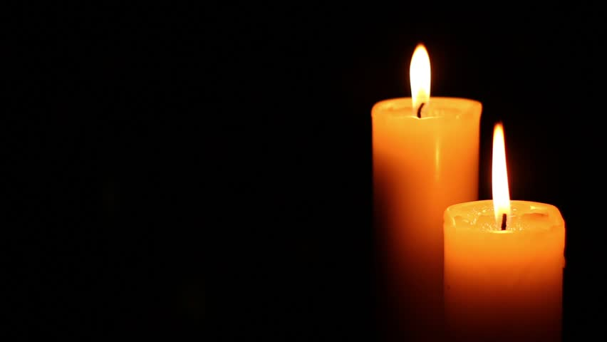 Four Candles Lit Right Bright Light On Dark Background
