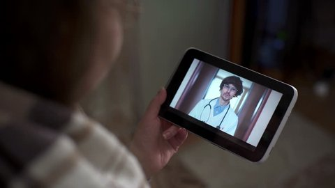 Patient video chatting with doctor