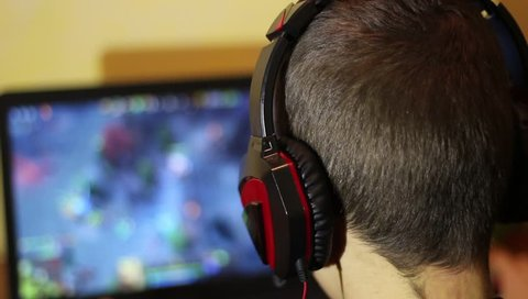 eSports. Teenager playing a strategy video game