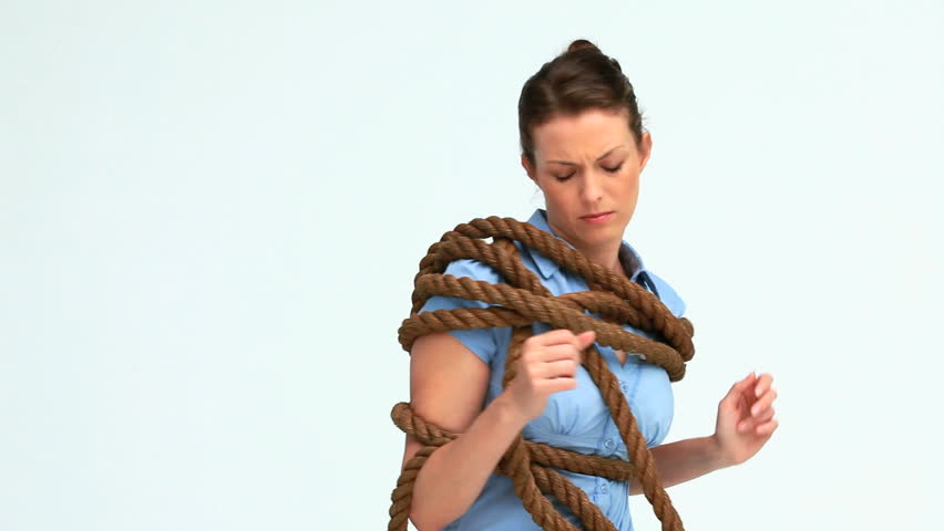 Businesswoman attached with a rope against white background | Shutterstock HD Video #2383655