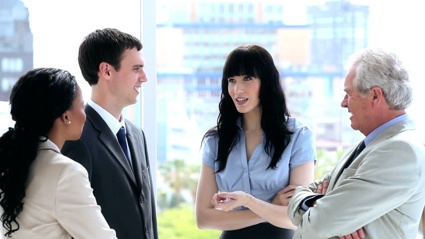 Business people standing white talking together in a bright room | Shutterstock HD Video #2384432