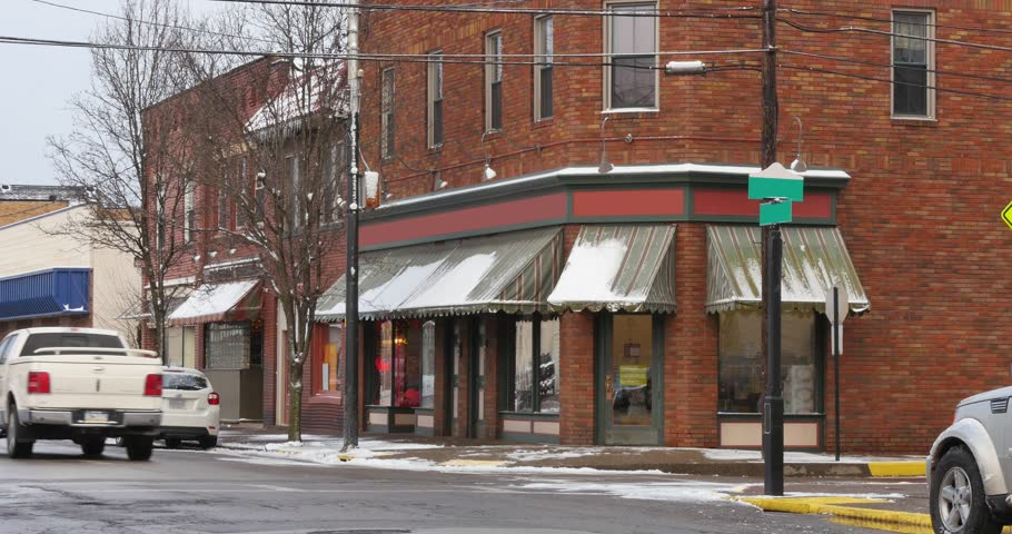 A wintry establishing shot of a corner bar or restaurant in a small town in Western Pennsylvania. Signage digitally removed for general stock usage.