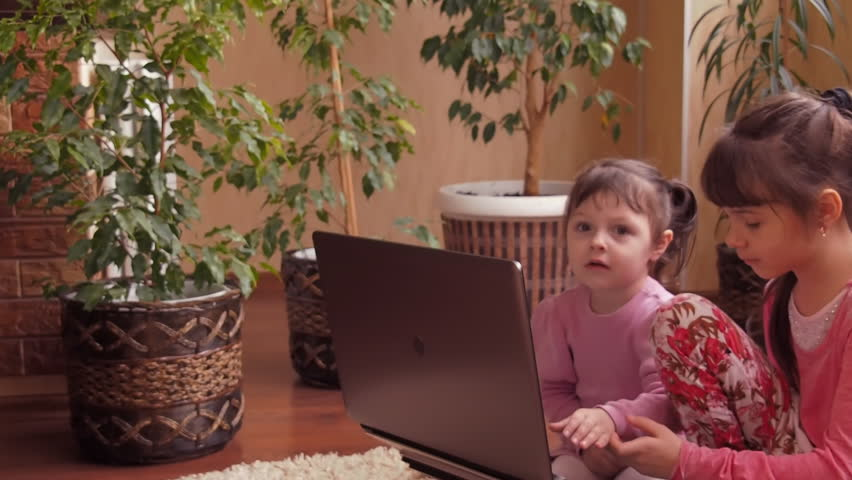 Family with laptop.    Shutterstock HD Video #23884945