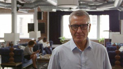 Portrait Of Mature Businessman In Office Shot On R3D