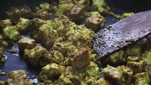 fried paneer in the pan. Vegetarian cuisine and its dishes. Paneer homemade cheese and dishes from it