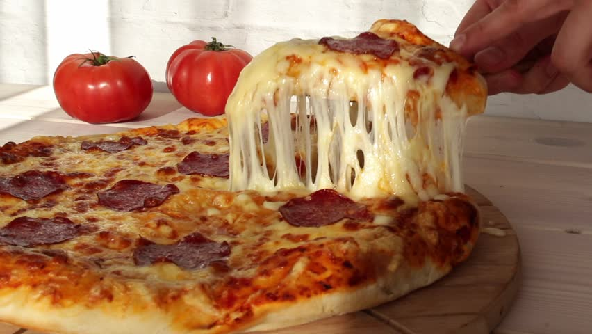 taking slice of pizza with super stretching cheese