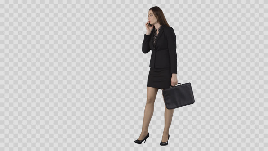Sexy business woman in short skirt is strolling an talking by phone. Clip with alpha channel