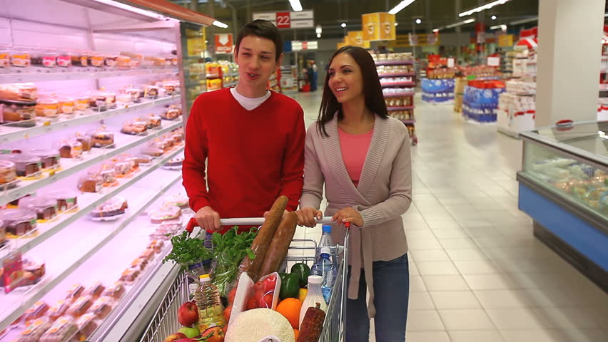 Young people doing shopping together in a modern big supermarket | Shutterstock HD Video #2395445