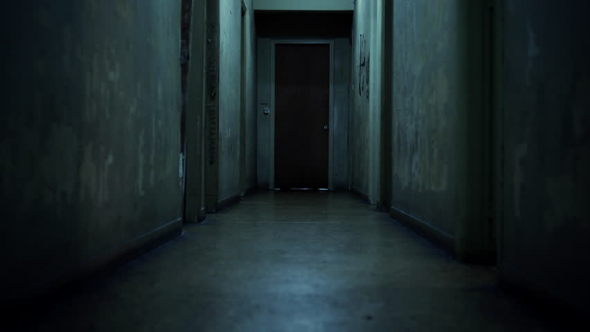 Walking Inside A Long Dark Hallway Of An Old Apartment Building