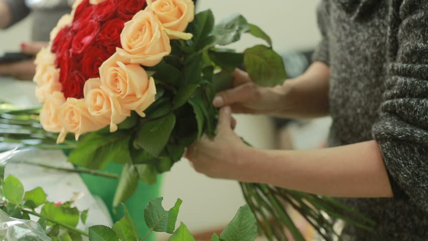 Bright colorful bouquet of red and peach roses, florist woman gathers a bouquet | Shutterstock HD Video #23986342