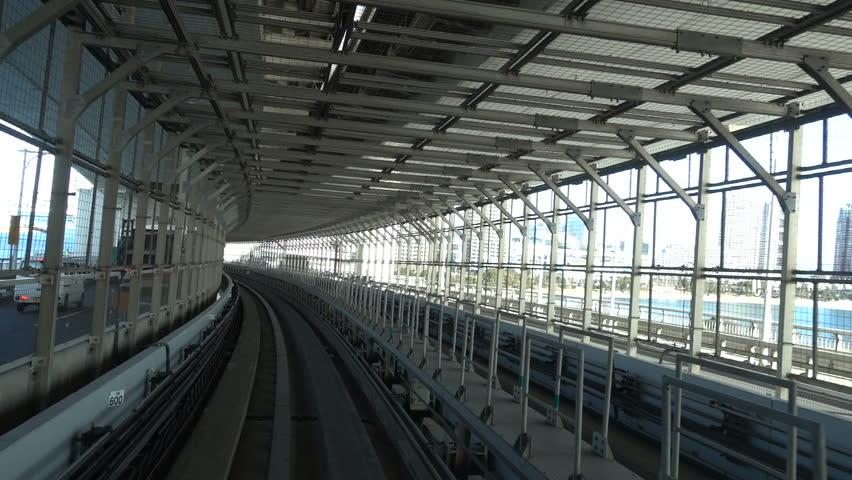 Okyo- Circa February 2017: POV of Yurikamome Computerized Train from Shinbashi to Big Sight Convention Center | Shutterstock HD Video #24037945