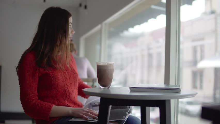 Beautiful woman reading newspaper, drinking coffee in cafe   Shutterstock HD Video #24038995
