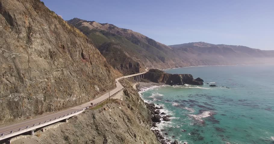 Bridge Rock Car tracking Pull back Aerial, 4K, 34s, 7of10, Stock Video Sale - Drone Discoveries llc..mov   Shutterstock HD Video #24056125