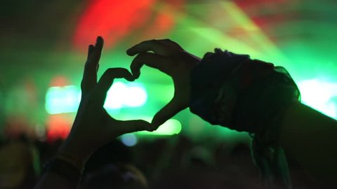 hands in the shape of hearts concert