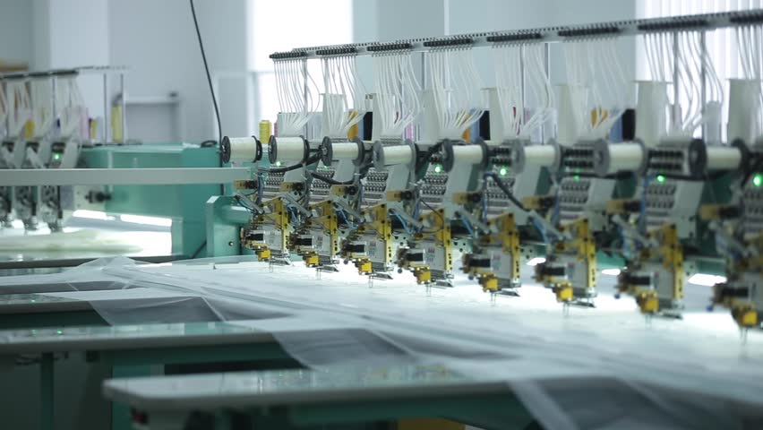 Textile industry with knitting machines in factory. | Shutterstock HD Video #24078478