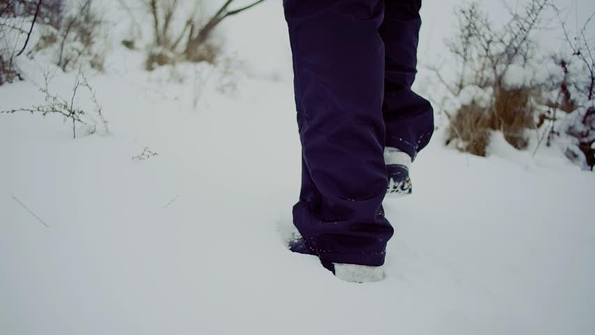 Slow motion. walk man whith backpack feet steps in snow winter landscape | Shutterstock HD Video #24078985