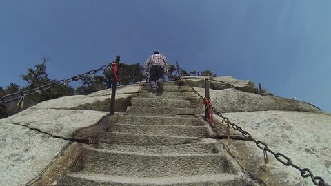 Views of walking to the South Peak of Mount Huashan up the deadly stone stairs near to the plank walk in the sky, in China`s Mt Huashan`s highest peaks, Shanxi province, central China