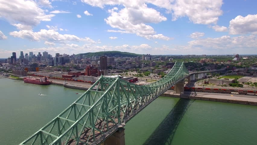 Montreal aerial view, Jacques Cartier bridge over the Saint Lawrence river in Quebec, Canada.