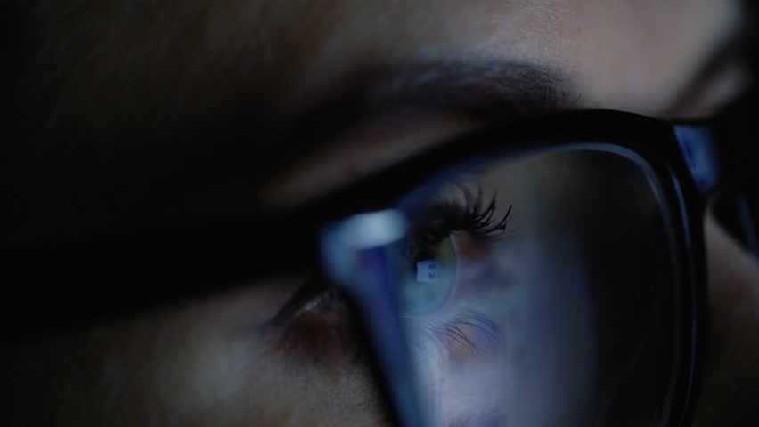 Woman in glasses looking on the monitor and surfing Internet #24165730