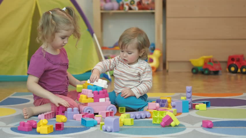 Toys For Boys Kindergarten : Boy and girl build toy children kid baby play with