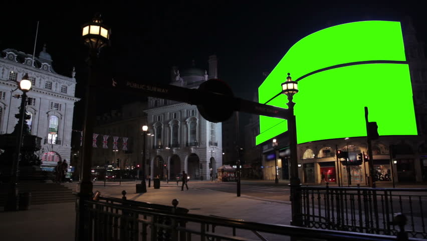 Piccadilly Circus at night WS with green screens