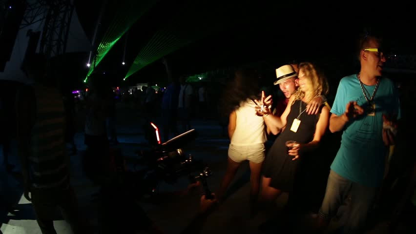 ANAKLIA, GEORGIA - AUGUST 20, 2016. The cameraman shoots people dancing in a disco
