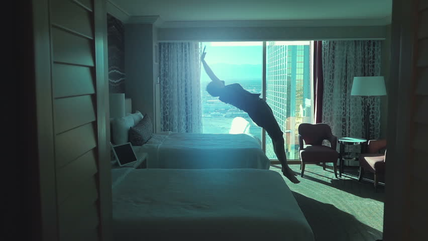Two high quality videos of man jumping on the bed in real 1080p slow motion 250fps