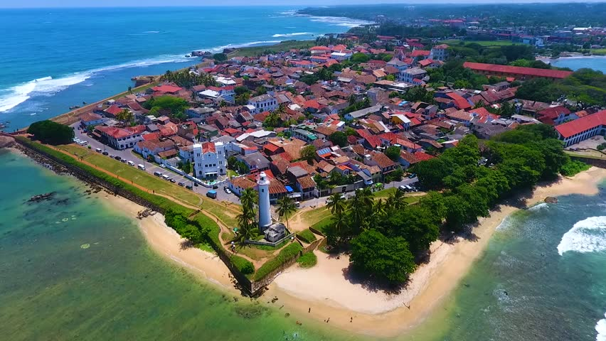 Fly around lighthouse on the coast of indian ocean. Aerial video Galle Sri Lanka #24259835