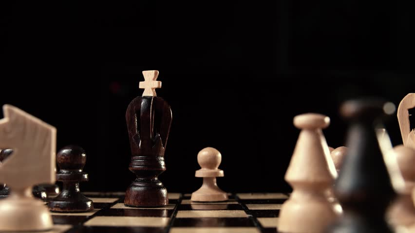 Pawn King beats. chess closeup, wooden chess board, business concept, black background. slide camera. Studio. Hand made chess | Shutterstock HD Video #24272645
