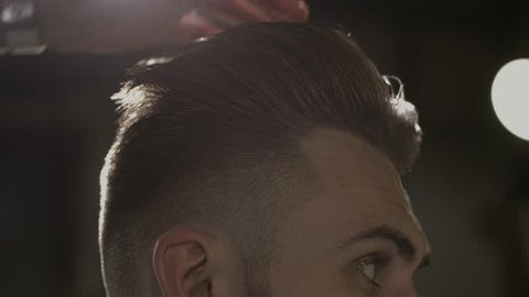 Men's hairstyling in a barbershop or hair salon. Barbershop.