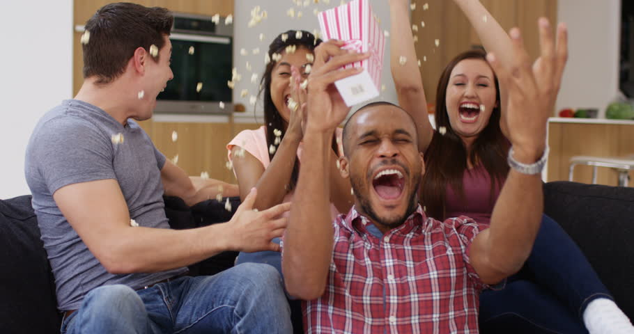 4k, Group of young friends throw popcorn on themselves while celebrating watching TV