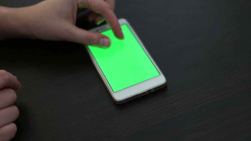 Touch Screen On White Smartphone Green Screen.Using Smartphone,Holding Smartphone with Green Screen | Shutterstock HD Video #24309365