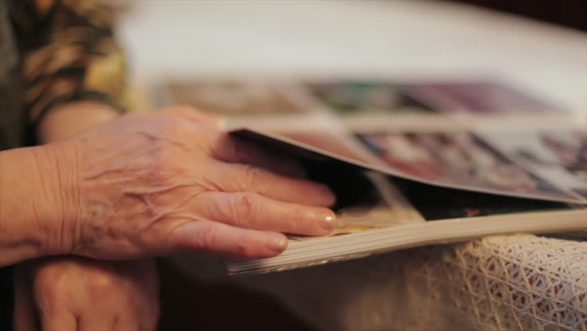 Old Woman Looking At A Photo In Old Photo Album, Memories, Tilt Up