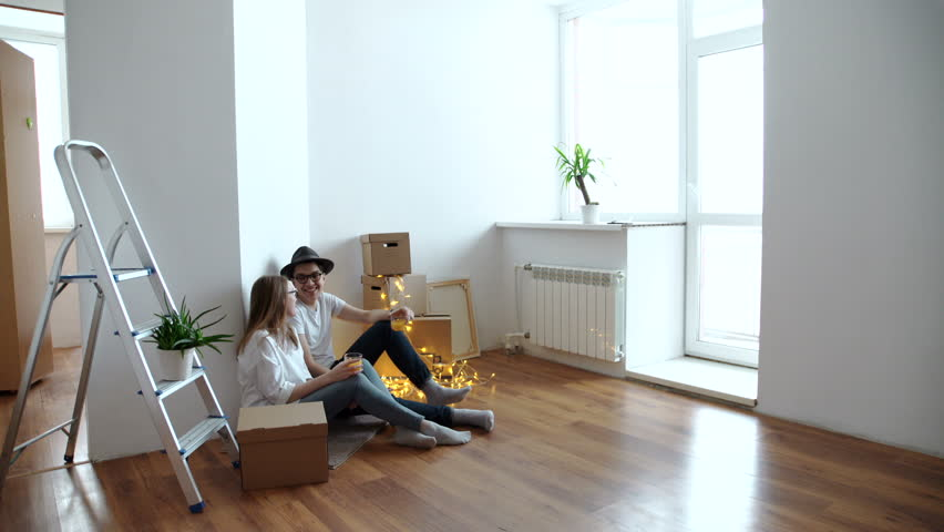 Cute couple taking a break from unpacking in their new home | Shutterstock HD Video #24327875