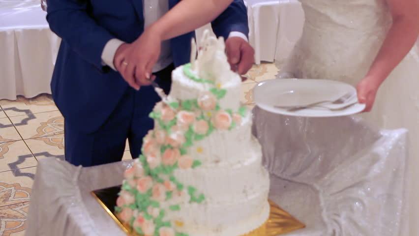 Couple cut the wedding cake | Shutterstock HD Video #24329735
