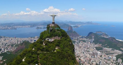 RIO DE JANEIRO, BRAZIL - FEBRUARY 2017: Aerial view of Christ the Redeemer Statue on the top of Corcovado Hill. This the famous landmark of Rio and symbol of Christianity across the world
