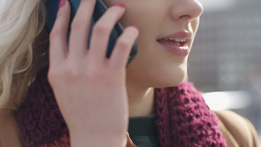 4K Female mouth talking on her phone outdoors, in slow motion  | Shutterstock HD Video #24343205