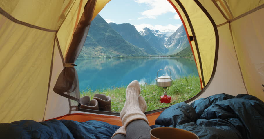 Camping woman lying in tent Close up of Girl feet wearing hiking boots relaxing on vacation POV | Shutterstock Video #24370088
