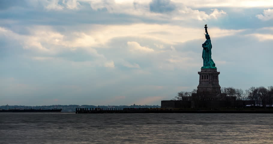 Liberty Island, New York City, USA - Statue of Liberty National Monument seen from Ellis Island on a windy day with moving clouds - Timelapse without motion - 01/2016 | Shutterstock HD Video #24479165