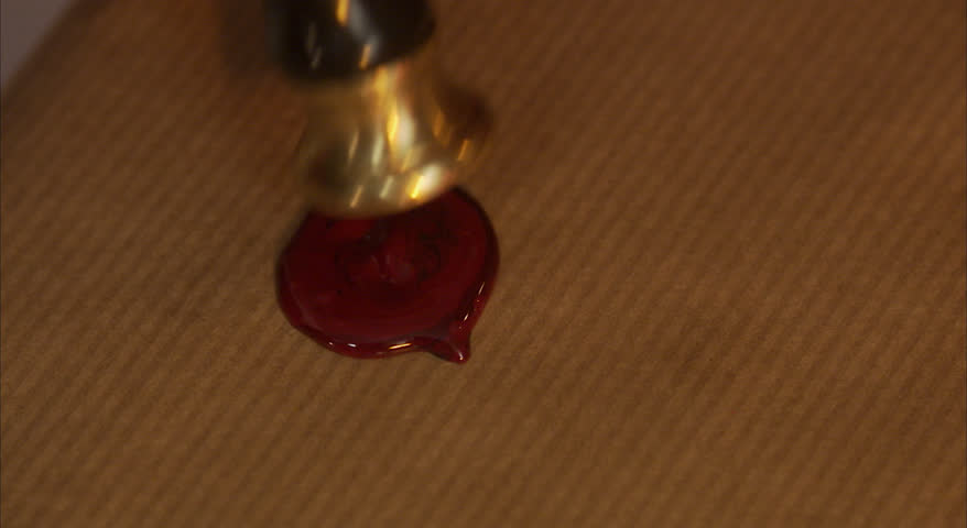 Sealing a Christmas present with sealing wax